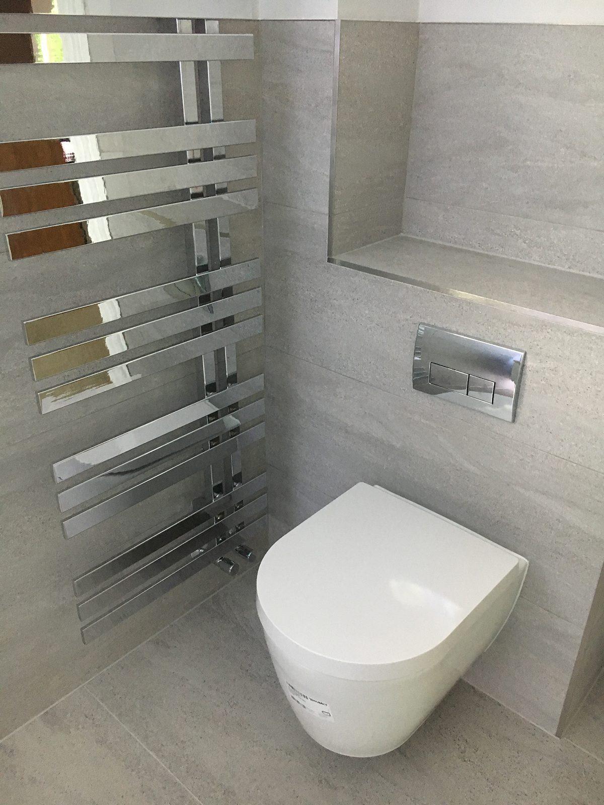 The Cambridge Bath Co bathroom toilet and wall heater radiator