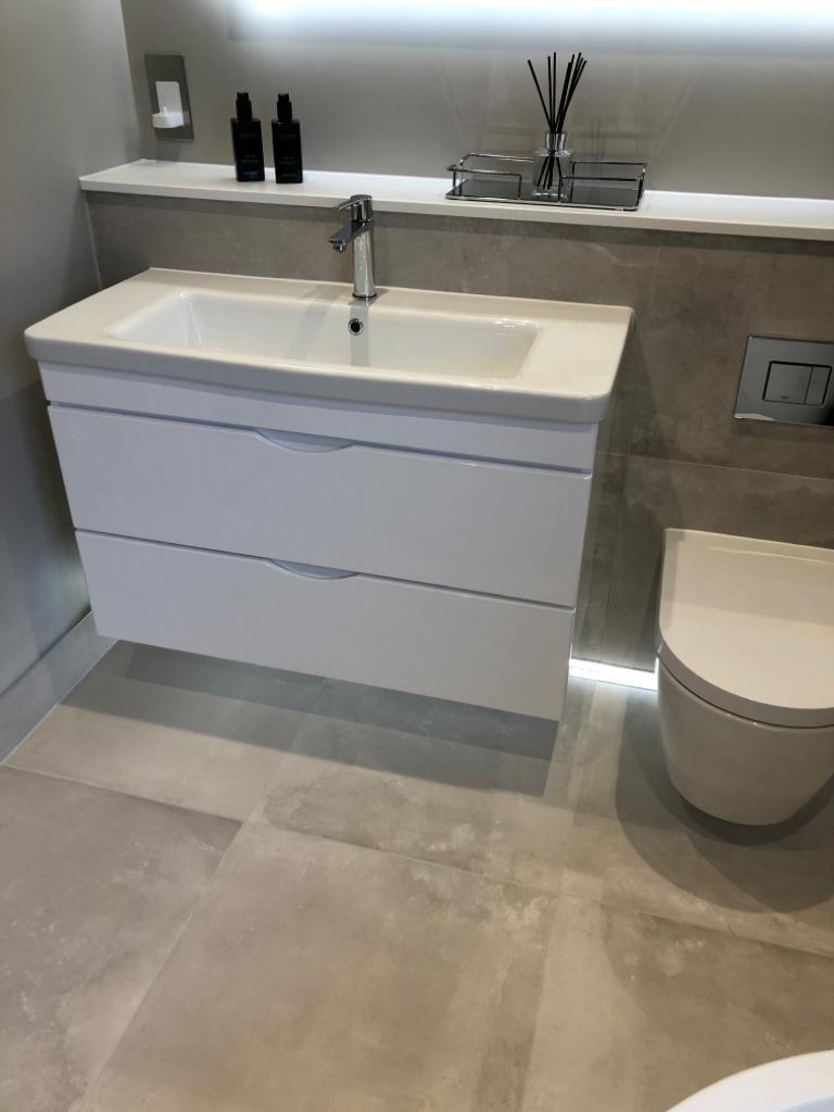 The Cambridge Bath Co bathroom sink and toilet