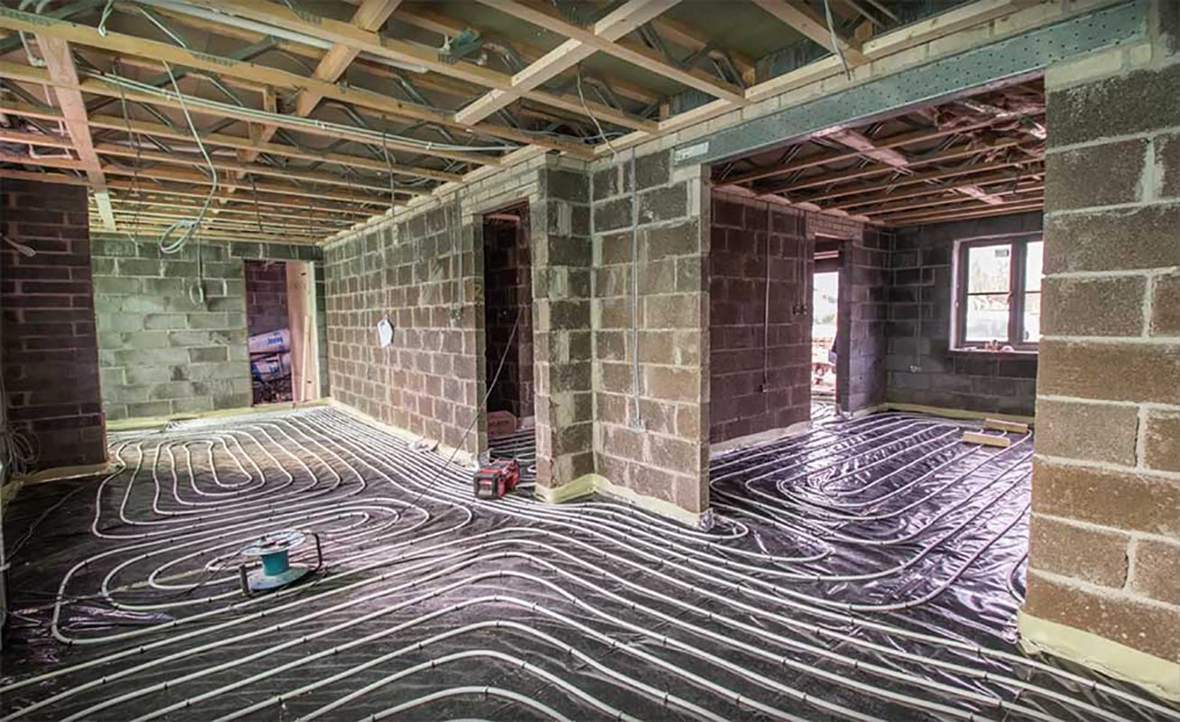 Underfloor heating pipes installed